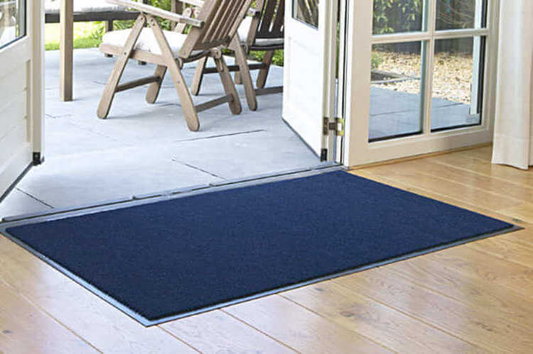 a blue dust control mat